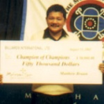 Reyes holds the winning check.